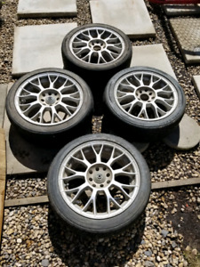 Set of 16 inch 4x100 rims with tires (205/45r16)