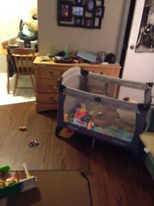 Graco turquoise and grey Winnie the Pooh playpen