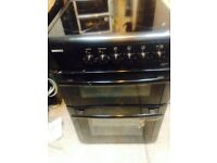 Beko black glass top cooker 60cm wide with a double oven