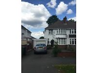 A large three bedroom property with driveway and garage