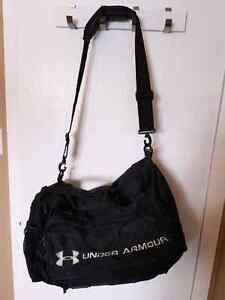 Large black Under Armour duffel bag
