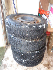 4 Studded Tires mounted on Rims