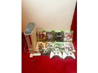 Xbox 360, Wireless adapter, 2 Controllers, 9 Games. Offers Considered
