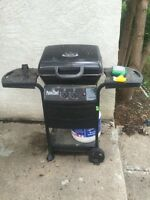Bbq and two propane tanks