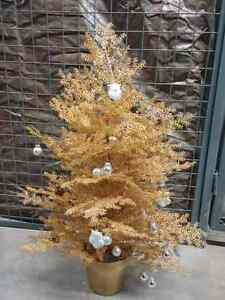 Miniature sparkly gold Christmas tree