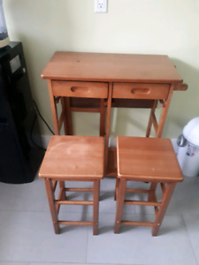 Table and stow away stools