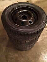 195/60r14 Snow tires and rims. Bolt pattern is 4X100 & 4X114.3