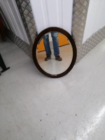 Dark oak oval mirror