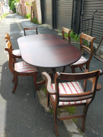 Reproduction extendable table and chairs