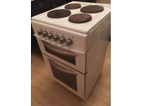 Electric cooker with grill and oven