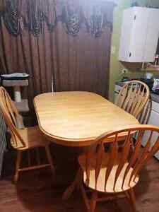 Oak dining table with matching china cabinet