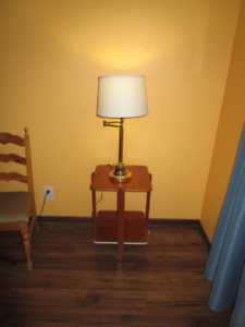 Night stand and brass table lamp