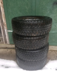 245/65/17 winter  studded tires on rims