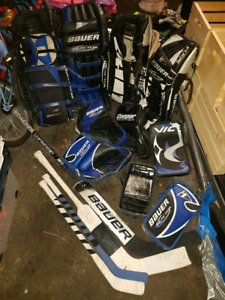 Two sets of goalie gear plus extras and sticks