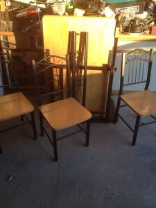 TABLE AND 4 CHAIRS - IN GOOD CONDITION
