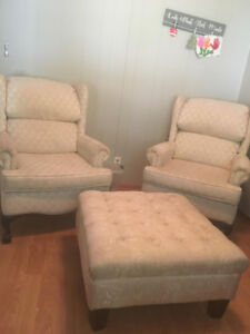 2 white wing back chairs with ottoman
