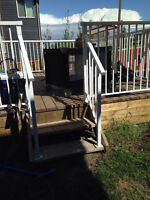 Deck stairs with white railing