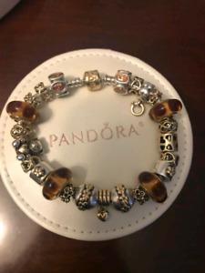 Pandora 14k gold and two tone charm bracelet