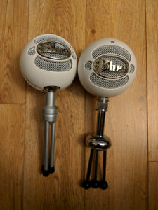 Two Blue snowball microphones.