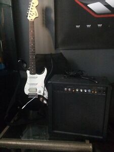 Fender guitar with amp