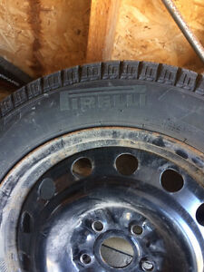 "Pirelli Winter Tires and Rims 16"" 205/55 R16 one winter"