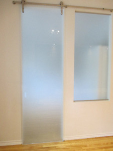 Large designer sliding frosted and tempered glass door