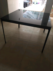 Glass dinning table seats 4 people