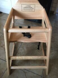Wooden high chair brand new