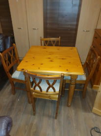 48. Pine table and chairs