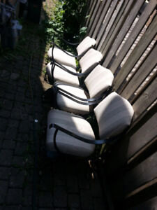 4 patio chairs cast heavy metal with wheels