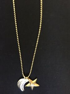 Gold coloured casual necklace with star & moon. Great condition!