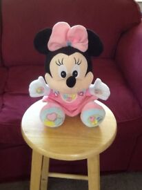 Disney Minnie Mouse soft talking cuddly toy.