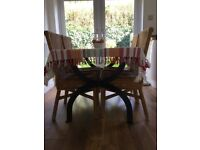 Dining table and four wicker chairs