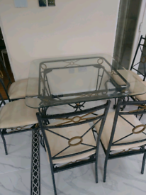 Nice dinning table glass top. 6 chairs