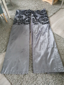 Pair of long grey curtains