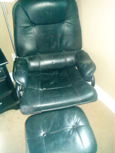 Black leather reclining chair with foot stool.