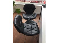 Black faux leather chairs