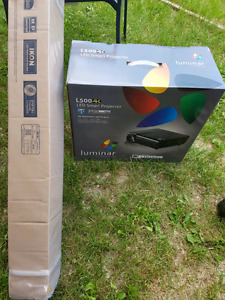 Brand New in Luminar L500 LED smart projector with IKON screen