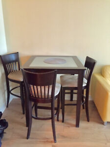 Solid wood glass top bar table with 4 chairs for sale.