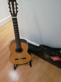 Solid Top Classical Guitar, case and stand