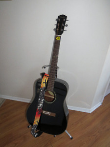 Black FENDER Acoustic DG-60 Guitar with stand and strap