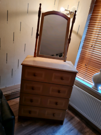 Solid wooden chest of drawers with mirror.