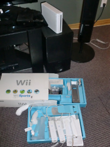 WII CONSOLE AND Accessories (barely used - still in box)