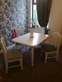 Dining table and chairs. Sits 4-6 extending
