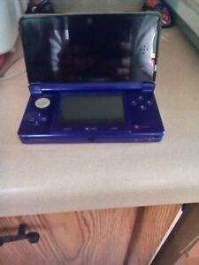 3DS FOR SALE with CHARGING CABLE AND GAMES