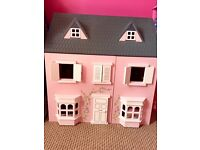 Girls wooden dolls house and accessories