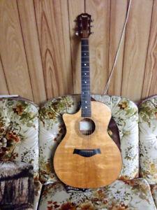 Left-handed 2001 Taylor 314-ce acoustic guitar