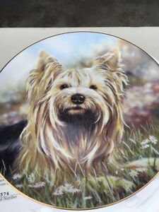4 Danbury mint collector plates