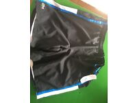 Brand new with tags Lacoste sports shorts medium size