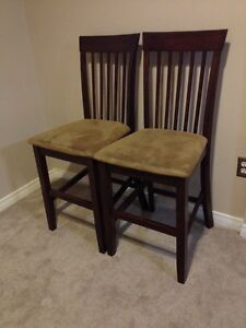 2 high brown chairs